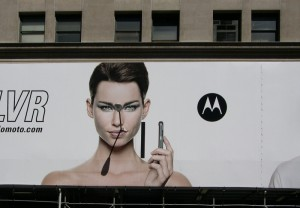 street lamp sticking out of mouth of person on billboard
